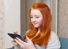 Young girl uses tablet computer Stock Image