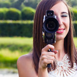 Young girl using aт old camera Royalty Free Stock Photography