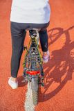 Young girl using bicycle on hiking trail. stock images