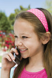 Young Girl Using Cell Phone Royalty Free Stock Images