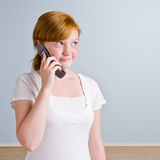Young girl using cell phone Royalty Free Stock Image