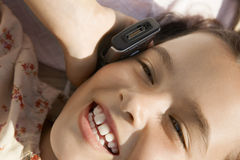 Young Girl Using Cellphone Royalty Free Stock Images