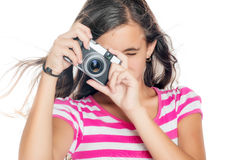 Young girl using a compact camera Royalty Free Stock Photos