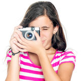 Young girl using a compact camera Stock Images