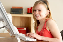 Young Girl Using Computer At Home Royalty Free Stock Photography