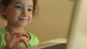 Young girl using computer for homework stock video