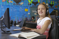 Young Girl Using Computer In Lab Royalty Free Stock Photo