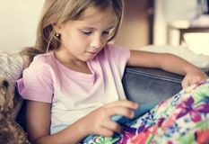 Young girl is using digital tablet Royalty Free Stock Image
