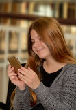 Young girl using her cellphone. Stock Photo