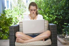 A young girl using her laptop outside Royalty Free Stock Photography