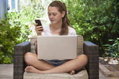 A young girl using her laptop outside Royalty Free Stock Photos