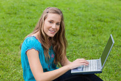 Young girl using her laptop in a park Royalty Free Stock Photos