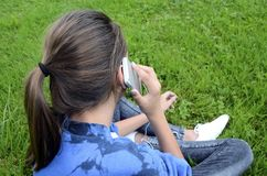 Young girl using her phone Stock Image