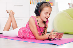 Young girl using her phone listening to music Stock Photo