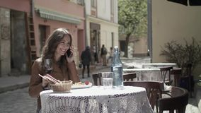 Young Girl Using Her Smartphone At Cafe stock video footage