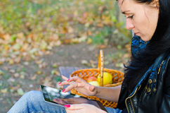 Young girl using her tablet Royalty Free Stock Photography