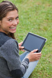 Young girl using her tablet pc Royalty Free Stock Images