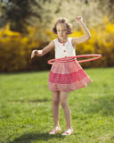 Young girl using hula hoop in a park Royalty Free Stock Photo