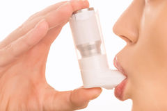 Young girl using inhaler Stock Images