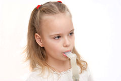 Young girl using inhaler Stock Image