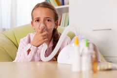 Young girl using inhaler device - relieve asthma and allergies s Stock Photography