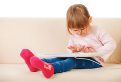 Young girl using a keybord. computer generation. Young girl using a keybord computer generation Royalty Free Stock Images