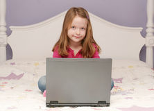 Young girl using a laptop Royalty Free Stock Photo