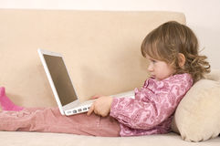 Young girl using a laptop Royalty Free Stock Images