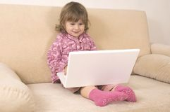 Young girl using a laptop Royalty Free Stock Photos