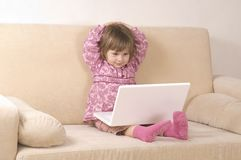 Young girl using a laptop Royalty Free Stock Photos