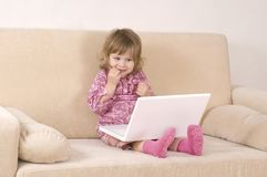 Young girl using a laptop Stock Image