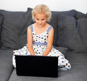Young girl using a laptop Stock Photos