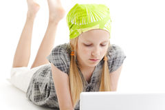 Young girl using a laptop computer Stock Photos