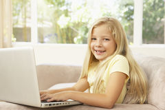 Young Girl Using Laptop At Home Royalty Free Stock Image