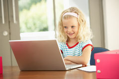 Young Girl Using Laptop At Home. Young Girl Using A Laptop At Home royalty free stock images