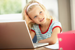 Young Girl Using Laptop At Home Royalty Free Stock Photos