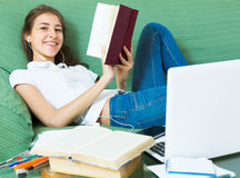 Young girl using laptop at home Stock Images