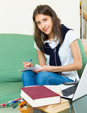 Young girl using laptop at home Stock Photo