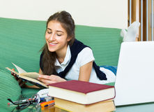 Young girl using laptop at home Stock Image