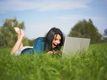 Young Girl Using Laptop In Park Royalty Free Stock Photo
