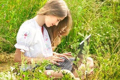 Girl with laptop outdoor Stock Images
