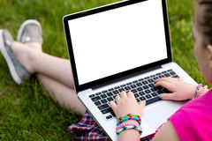 Young girl using the laptop Stock Image