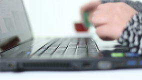 Young girl using laptop and writing keyboard. HD 1080 stock footage