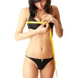 Young girl using measure tape around her chest Stock Photo