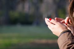 Young girl using a mobile / phone outdoor; dependence color ton Stock Image