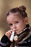 Young girl using nasal spray. Looking worried Stock Photos