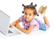 Young girl using notebook computer Stock Images