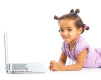 Young girl using notebook computer Stock Image
