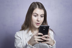 Young girl using a smartphone stock image