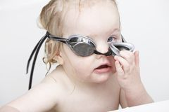 Young girl using swimming goggles in the bathtub Royalty Free Stock Photos